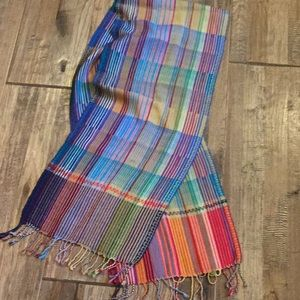 Long woven scarf with fringe.